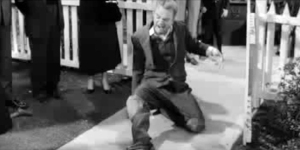 "Actor Jimmy Cagney playing Lon Chaney, portraying a ""cripple"" rising in a faith healing."